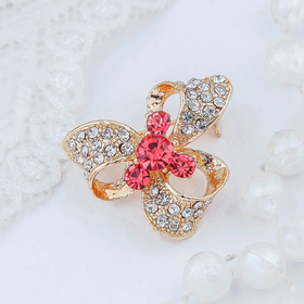 "Brooch ""Bow"" with stones, color pink and white gold"