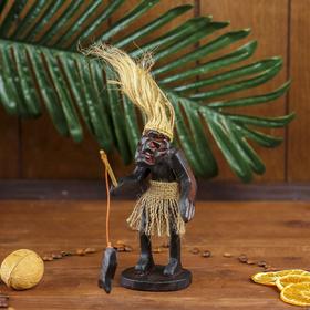 """A souvenir with a """"Native fisherman"""""""