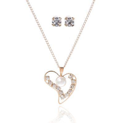 "Headsets 2 items: earrings, pendant ""Gravity"", a heart, white gold, 45cm"