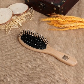 Massage comb, light wood color.