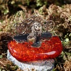 """Business card holder made of brass and amber, """"a lion with a shield"""" 6,7x4,5 cm"""