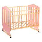 Детская кроватка «Чудо» на колёсах или качалке, цвет розовый