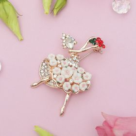 """The brooch sports """"Ballerina floral skirt"""", colored in gold"""