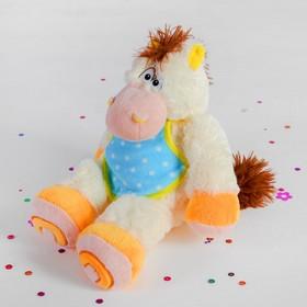 Мягкая музыкальная игрушка 'Лошадь' в передничке сидит Ош