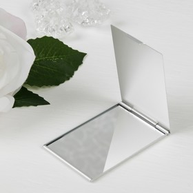 The mirror is a foldable, single-sided, no magnification, color silver