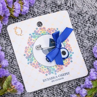 "Safety pin charm with bow ""Eye"", the color blue in silver"