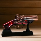The product on a stand, pistol, 4*10*18cm