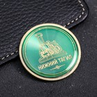 "The coin is inlaid with ""Nizhniy Tagil"""