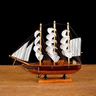 The ship gift mid - Board light wood with a brown stripe, three masts, white sails with stripe