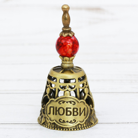"""A bell with an acrylic element of """"Love"""""""