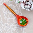 "The spoon is wooden ""Krasotka"", Polubotok, red background"