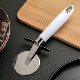 "A pizza cutter and dough ""Skin"", white"