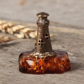Souvenir brass and amber Mayak