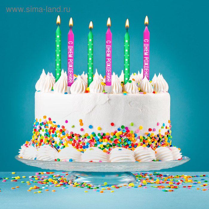 """A set of candles in the cake """"happy birthday"""""""