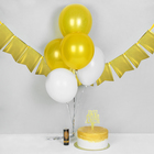 """Set a festive """"Congratulations!"""", gold: cracker, topper, garland, balloons"""