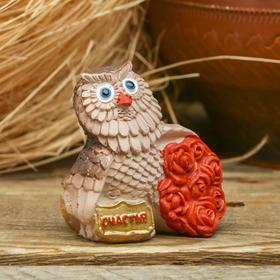 "Figurine souvenir of ""Happiness"""
