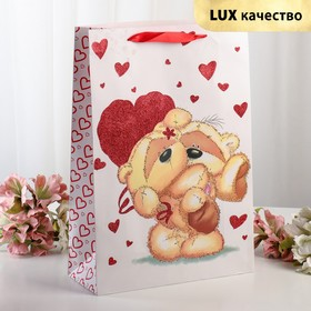 "The package laminated ""Love"" Suite, a 31 x 12 x 44 cm"