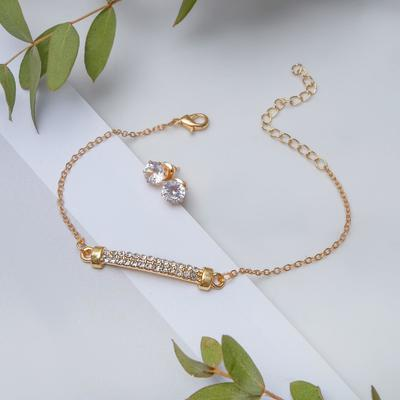"""Set of 2 pieces: a bracelet, ear studs set """"Modern"""" a number of crystals, white gold"""