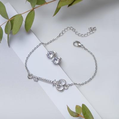 Set of 2 pieces: a bracelet, ear studs set Modern key, color white silver