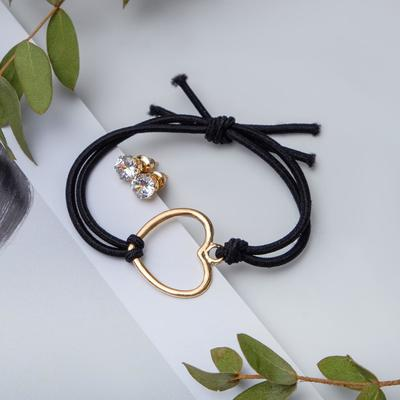 "Set of 2 pieces: a bracelet, ear studs set ""Modern"" as black gold"