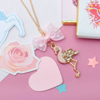 "Pendant baby ""Vibracula"" Flamingo with a bow, the color pink gold"
