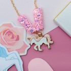"Pendant baby ""Vibracula"" sequins, a unicorn, the color pink and white gold"