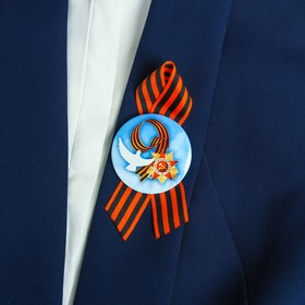 """Badge with ribbon """"may 9"""" the sky, the bird"""