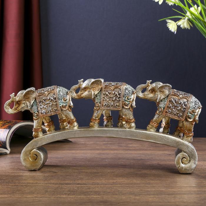"""Сувенир полистоун """"Серебристые слоны в ажурных бирюзовых попонах на дуге"""" 12,2х28х5,2 см"""
