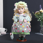 "Collectible ceramic doll ""Agnes in a green dress with bows"" 30 cm"