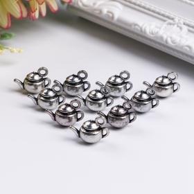 A set of metal pendants