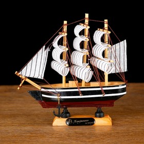 Ship souvenir small side black with a white stripe, three masts, white sails with stripe