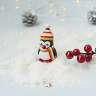 "The modeling of polymer clay ""Christmas figure"". Penguin in hat"