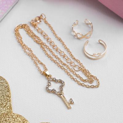 "A set of children's ""Vibracula"" 3 PR: pendant 40 cm, 2 rings, key, white gold"