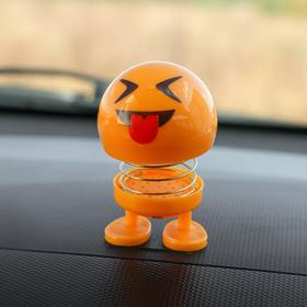 The smile on the spring, on a panel in the car, tongue, yellow