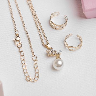 """A set of children's """"Vibracula"""" 3 PR: pendant 40 cm, 2 rings, flower, white gold"""