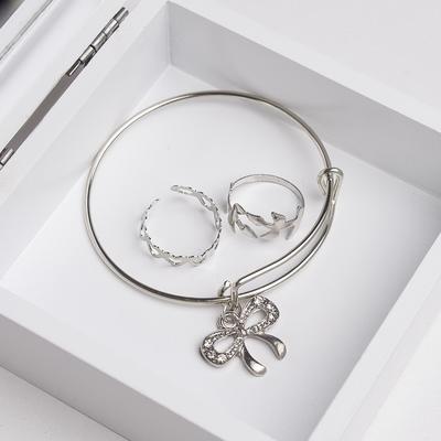 "A set of children's ""Vibracula"" 3 PR: bracelet, 2 rings, butterfly, color white silver"