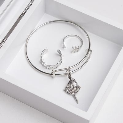 """A set of children's """"Vibracula"""" 3 PR: bracelet, 2 rings, ballerina, color white silver"""