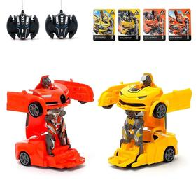 "A set of RC transformers ""battle of the Autobots"", battery powered, MIX"