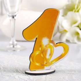 """A set of numbers on the table """"Gold"""", yellow"""