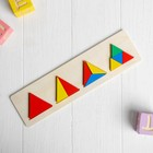 The learning material. The triangles Montessori