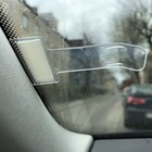 Clip under the windshield 7.5x4 cm, transparent