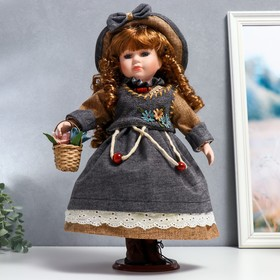 """Collectible ceramic doll """"Julia in a light caramel dress and hat"""" 40 cm"""