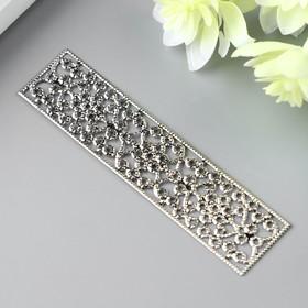 A decorative element, color dark silver