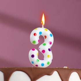 Candle in the cake on birthday number 3