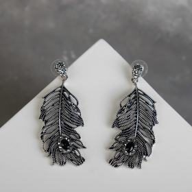 """Earrings with rhinestones """"Date"""" feathers, the colour is grey-black in blackened silver"""