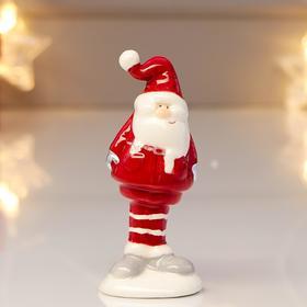 "Souvenir ceramic ""Santa Claus in a red coat, red striped cap"" 9,6х4х4,3 cm"
