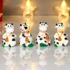 "Souvenir Polyresin ""Spotted cow with a Golden bell"" MIX 6,2x3,8x3,8 cm"