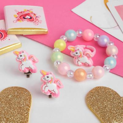 "A set of children's ""Vibracula"" 3 items: clip-on earrings, bracelet, ring, unicorns, colored"