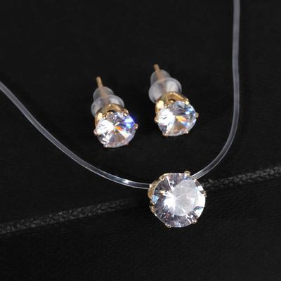 """Set of 2 items: earrings, pendant"""" on a fishing line """" classic, color white in gold"""