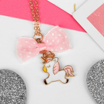 "Pendant children's ""Vibracula"" unicorn with bow, color white and pink gold"